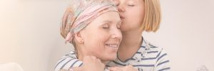 Girl hugging her ill mother with love