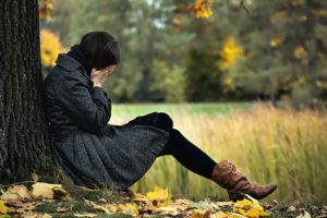 Young woman having autumn depression and crying